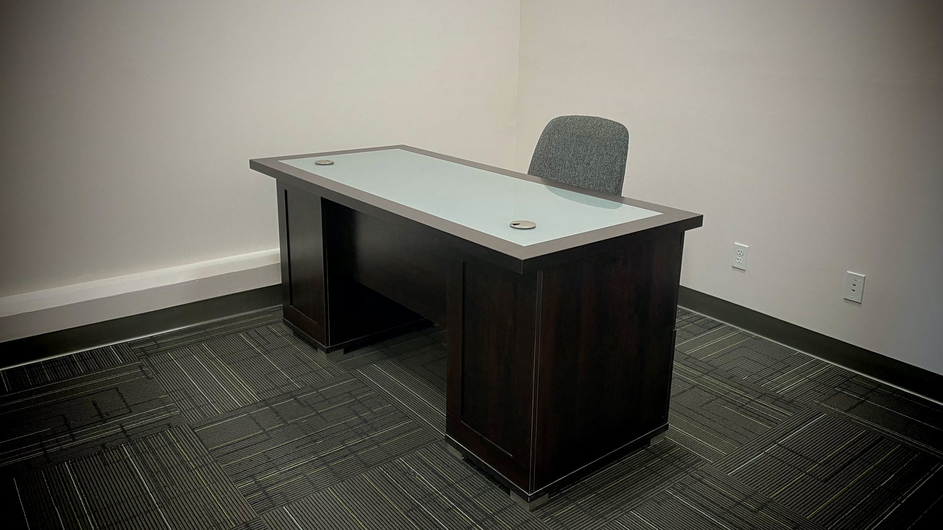 A spacious off with a desk and chair.