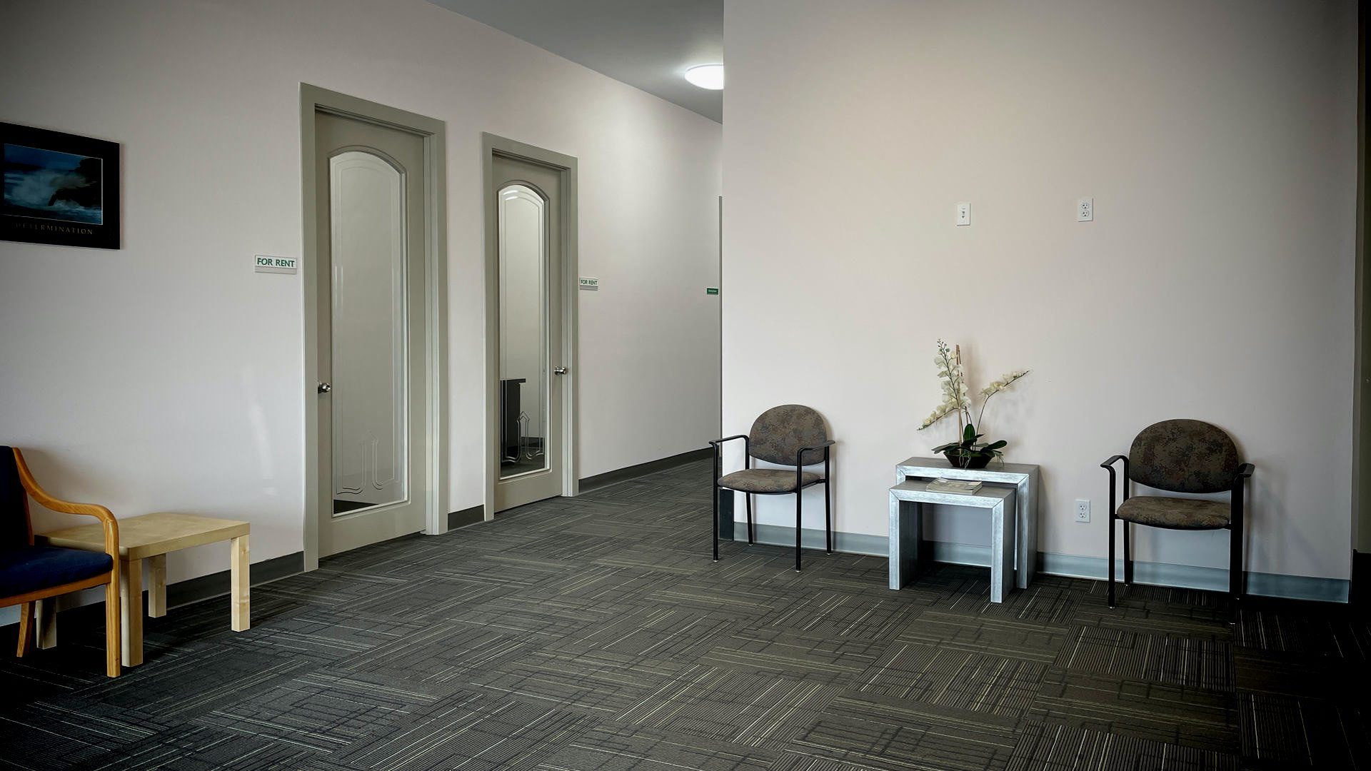 A well light office foyer with chairs.
